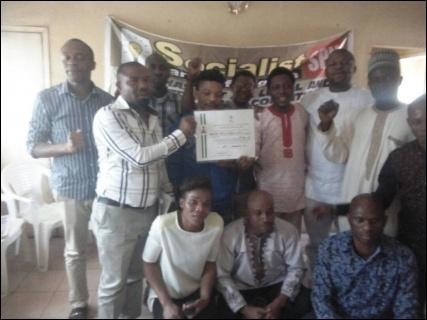 Party members celebrate with Certificate at SPN Secretariat in Abuja (150118) - photo DSM