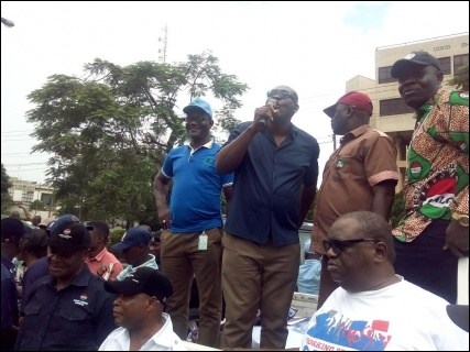 Achike Chude JAF Deputy Chair addressing protesters at Lagos State Government Secretariat - photo DSM