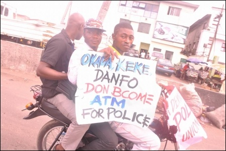 Protesting police using okada and danfo as ATMs